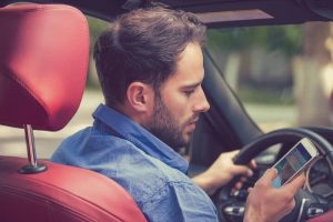 TEXTING WHILE DRIVING IS NEGLIGENT